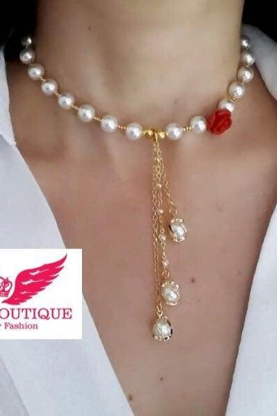 Beautiful pearl and rose necklace and earrings